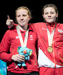 Left to right Wales' Rosie Eccles (silver) v England's Sandy Ryan (gold) following the Woman's Welter (64-69kg) final at Oxenford Studios during day ten of the 2018 Commonwealth Games in the Gold Coast, Australia.