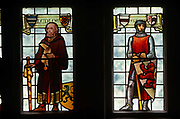 A heraldic official and a knight depict local historical events, both medieval figures appearing in stained glass windows part of an auction held by Bonhams of the contents of Stokesay Court, the oldest fortified estate house in Britain originating in the late 13th century.It is at present in the hands of English Heritage. It's a Grade I listed Victorian mansion that was locked up for decades before being sold off after the last member of the rich industrialist family of John Derby-Allcroft whose ancestors could no longer afford the property's upkeep. Its contents of almost pristine collection of Victoriana personal effects and furniture, clothing, and memorabilia that was largely stored away from the fading and deteriorating qualities of daylight.