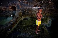 cuban boy swimming on coast
