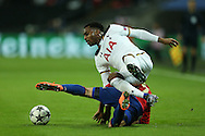 Danny Rose of Tottenham Hotspur is brought down by Zoran Tosic of CSKA Moscow. UEFA Champions league match, group E, Tottenham Hotspur v CSKA Moscow at Wembley Stadium in London on Wednesday 7th December 2016.<br /> pic by John Patrick Fletcher, Andrew Orchard sports photography.