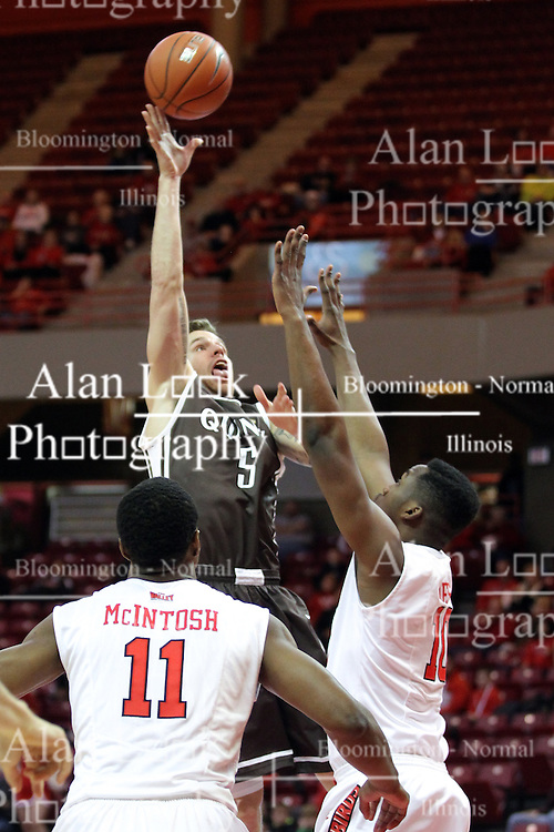 29 December 2014:  Scottie Bruxvoort lifts a shot over John Jones during an NCAA non-conference interdivisional exhibition game between the Quincy University Hawks and the Illinois State University Redbirds at Redbird Arena in Normal Illinois.