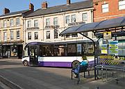 Single-decker Faresaver bus town centre bus stop, Market Place, Devizes, Wiltshire, England, UK