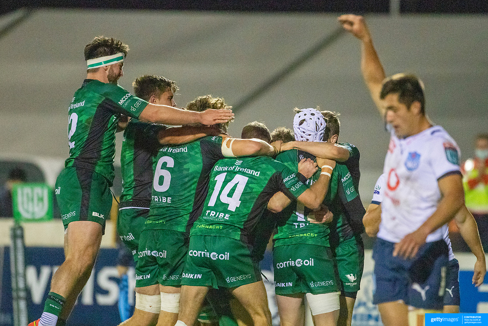 GALWAY, IRELAND:  October 01:   Mack Hansen #11 of Connacht is congratulated by team mates after scoring a spectacular try during the Connacht V Vodacom Bulls, United Rugby Championship match at The Sportsground on October 1st, 2021 in Galway, Ireland. (Photo by Tim Clayton/Corbis via Getty Images)