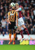 Burnley's Ben Mee vies for possession with Hull City's Ahmed Elmohamady<br /> <br /> Photographer: Chris Vaughan/CameraSport<br /> <br /> Football - Barclays Premiership - Hull City v Burnley - Saturday 9th May 2015 - Kingston Communications Stadium - Hull<br /> <br /> © CameraSport - 43 Linden Ave. Countesthorpe. Leicester. England. LE8 5PG - Tel: +44 (0) 116 277 4147 - admin@camerasport.com - www.camerasport.com