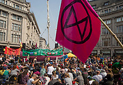 Activists with Extinction Rebellion protest about climate change in a blocked-off Oxford Circus, on 17th April 2019, in London, England.