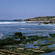 Crystal Cove State Park, located in Laguna Beach, has 3.2 miles of beach and 2,400 acres of undeveloped woodland.  It is a popular destination in Southern California for hiking and horseback riding. The offshore waters are designated as an underwater park. Crystal Cove is used by mountain bikers inland and scuba and skin divers underwater. The beach contains tidepools and sandy coves which can be explored by visitors.