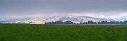 Looking south towrad the Takatimu Mountains on a cloudy day from near the Oreti River on Centre Hill Road near Mossburn, Southland, New Zealand