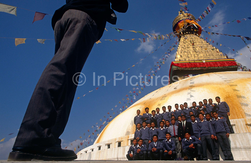 Nepali boys pose for a group photo under Kathmandu's Boudhanath Stupa after recruitment into the British Gurkhas. Trying for places in the Gurkha Regiment is part of a tough endurance series to find physically perfect specimens for British army infantry training. They will need to perform 25 straight-kneed sit-ups at a 45° slant both within 60 seconds to pass. 60,000 boys aged between 17-22 (or 25 for those educated enough to become clerks or communications specialists) report to designated recruiting stations in the hills each November, most living from altitudes ranging from 4,000-12,000 feet. After initial selection, 7,000 are accepted for further tests from which 700 are sent down here to Pokhara. Only 160 of the best boys succeed in the journey to the UK. The Gurkhas have been supplying youth for the British army since the Indian Mutiny of 1857.