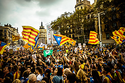 September 28, 2017 - Barcelona, Catalonia, Spain - Catalan pro-independence students wave flags as they gather in front of the historic building of the University of Barcelona in support of the planned secession referendum at October1st. Spain's constitutional court has suspended the Catalan referendum law after the Central Government has challenged it in the Courts (Credit Image: © Matthias Oesterle via ZUMA Wire)