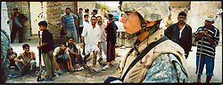 Soldiers with 4-14 Cav 172nd Stryker Battalion sweep through the streets of Shula - a predominantly Shiite area of northwestern Baghdad - on Sat. August 19, 2006.  The 172nd was extended at the last moment - with portions of the brigade already back in the States - when they were called upon to bolster security forces in Baghdad seeking to get a handle on a massive wave of sectarian killings in the Iraqi capital. This effort - labelled Operation Together Forward - has thus far seen US and Iraqi forces conduct cordon and searches of four of the most violence-plagued districts in the capital.