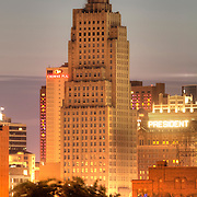 Vertical photo of the antique, art deco skyscraper The Power and Light Building in downtown Kansas City, Missouri. Undergoing renovation into residential apartments by NorthPoint Development at time of photograph.