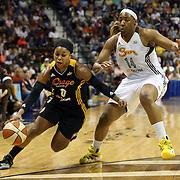 Odyssey Sims, (left), Tulsa Shock, drives past Kelsey Bone, Connecticut Sun, during the Connecticut Sun Vs Tulsa Shock WNBA regular season game at Mohegan Sun Arena, Uncasville, Connecticut, USA. 3rd July 2014. Photo Tim Clayton