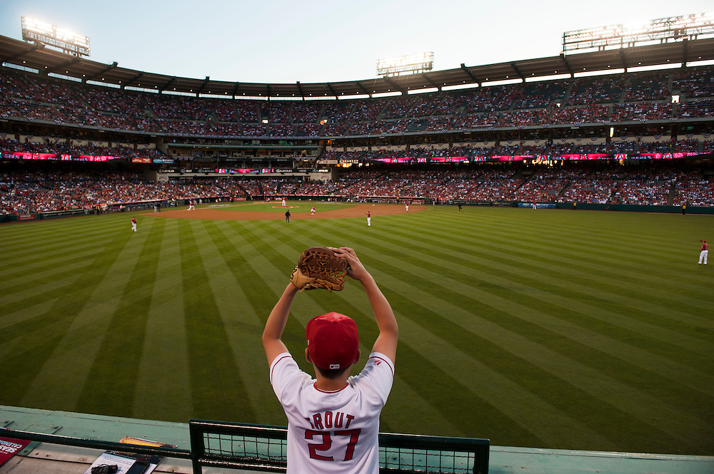 Ryder Rankin, 12, of Riverside, looks for a ball from Mike Trout before the Angels' home opener Monday at Angel Stadium.<br /> <br /> ///ADDITIONAL INFO:   <br /> <br /> angels.0405.kjs  ---  Photo by KEVIN SULLIVAN / Orange County Register  --  4/4/16<br /> <br /> The Los Angeles Angels take on the Chicago Cubs during their 2016 home opener Monday at Angel Stadium.<br /> <br /> <br />  4/4/16