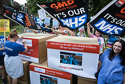 NHS workers from the grassroots NHSPay15 campaign prepare to march from opposite Parliament to 10 Downing Street with a petition signed by over 800,000 people calling for a 15% pay rise for NHS workers on 20th July 2021 in London, United Kingdom. At the time of presentation of the petition, the government was believed to be preparing to offer NHS workers a 3% pay rise in 'recognition of the unique impact of the pandemic on the NHS'.