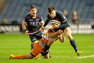 Blair Kinghorn (#15) of Edinburgh Rugby is tackled during the Guinness Pro 14 2018_19 match between Edinburgh Rugby and Toyota Cheetahs at BT Murrayfield Stadium, Edinburgh, Scotland on 5 October 2018.