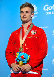Gold Medallist in the Men's 1m Springboard Final England's Jack Laugher receives his medal at the Optus Aquatic Centre during day seven of the 2018 Commonwealth Games in the Gold Coast, Australia.