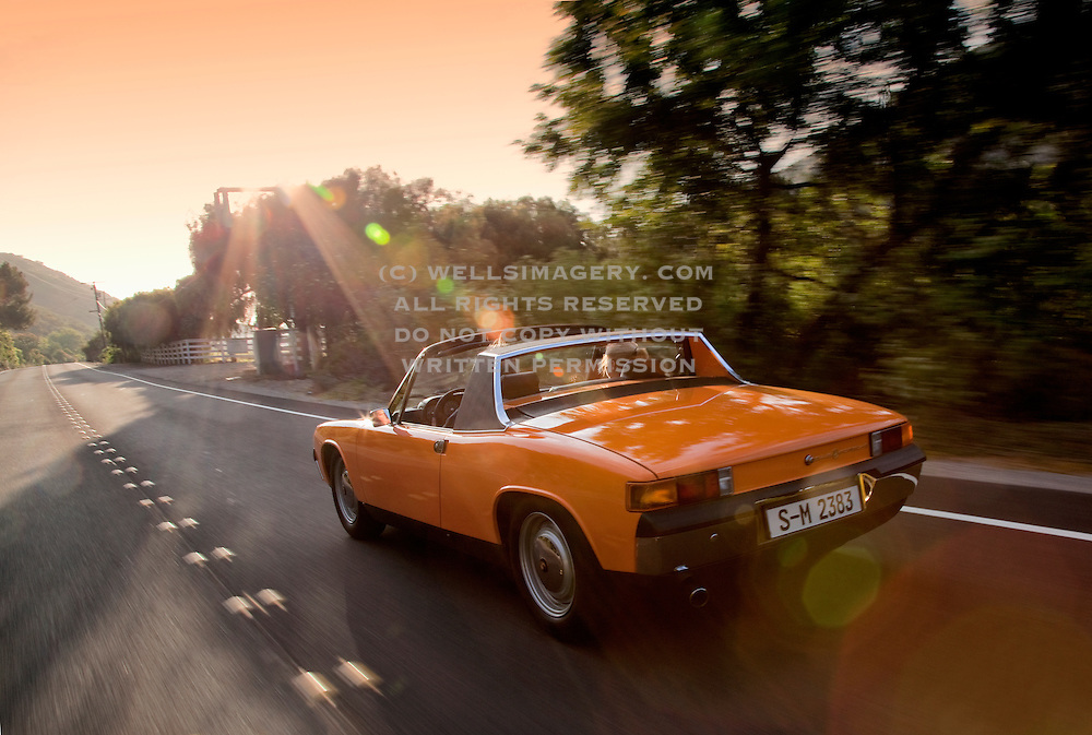 Automotive Car Photographer, Writer and Videographer Randy Wells, Image of an orange targa sportscar on a country road in Camarillo, California, west coast, Porsche 914-6, model and property released