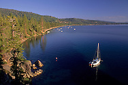 Sailboat anchored in the clear blue water of Lake Tahoe, California