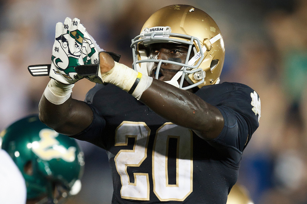 Notre Dame running back Cierre Wood (#20) flashes his leprechaun gloves after scoring touchdown in action during NCAA football game between Notre Dame and South Florida.  The South Florida Bulls defeated the Notre Dame Fighting Irish 23-20 in game at Notre Dame Stadium in South Bend, Indiana.