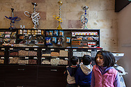 Children buying goods in 'Halep', a Syrian shop in Armenia's capital, Yerevan, stocked with produce from Aleppo, Syria.