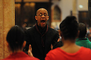 """Timothy Walker leads an ensemble choir of Chicago Catholic School students during the 33rd Annual African American Heritage Month Eucharistic Celebration at Holy Name Cathedral. This year's mass celebrates the the Nguzo Saba principle of Kuumba, or """"creativity"""" at Holy Name Cathedral."""