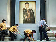 18 AUGUST 2015 - BANGKOK, THAILAND: Workers at the Erawan Mall sweep up glass from shattered windows in front of a fashion store in the mall. An explosion at Erawan Shrine, a popular tourist attraction and important religious shrine in the heart of the Bangkok shopping district, killed at least 20 people and injured more than 120 others, including foreign tourists, during the Monday evening rush hour. Twelve of the dead were killed at the scene. Thai police said an Improvised Explosive Device (IED) was detonated at 18.55. Police said the bomb was made of more than six pounds of explosives stuffed in a pipe and wrapped with white cloth. Its destructive radius was estimated at 100 meters.    PHOTO BY JACK KURTZ
