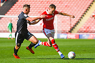 Ryan Hedges of Barnsley (7) and Sam Smith of Shrewsbury Town (17) in action during the EFL Sky Bet League 1 match between Barnsley and Shrewsbury Town at Oakwell, Barnsley, England on 19 April 2019.