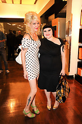 Left to right, TARA PERKINS and BETH DITTO at a party to celebrate the launch of Bang a new male fragrance by Marc Jacobs held at the Fith Floor Restaurant, Harvey Nichols, Knightsbridge, London on 22nd July 2010.