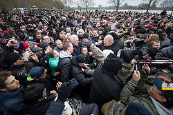 """© Licensed to London News Pictures . 18/03/2018 . London , UK . TOMMY ROBINSON (centre, falling to the ground) arrives to deliver his speech to the crowd . 1000s including supports of alt-right groups such as Generation Identity and the Football Lads Alliance , at Speakers' Corner in Hyde Park where Tommy Robinson reads a speech by Generation Identity campaigner Martin Sellner . Along with Brittany Pettibone , Sellner was due to deliver the speech last week but the pair were arrested and detained by police when they arrived in the UK , forcing them to cancel an appearance at a UKIP """" Young Independence """" youth event , which in turn was reportedly cancelled amid security concerns . Photo credit: Joel Goodman/LNP"""