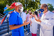 01 AUGUST 2020 - DES MOINES, IOWA: AKO ABDUL-SAMAD, left, a Democratic member of the Iowa House of Representatives, talks to Dr. YOGESH SHAH, after Dr. Shah and others called for a mask mandate at the Iowa State Capitol Saturday. About 50 doctors, medical professionals, and public health professionals from across Iowa came to the State Capitol to demand that Iowa Governor Kim Reynolds impose a mask mandate to control the spread of the coronavirus (SARS-CoV-2). Despite the continued spread of the coronavirus and rapidly increasing infection rate for COVID-19, the Governor has refused to impose a mask mandate or close businesses. For the week ending Saturday, Aug. 1, Iowa reported new 2,736 new cases of COVID-19.             PHOTO BY JACK KURTZ