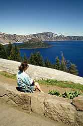 OR: Oregon; Crater Lake National Park, scenic view of Crater Lake, model released           .Photo Copyright Lee Foster, lee@fostertravel.com, www.fostertravel.com, (510) 549-2202.Image orcrat219