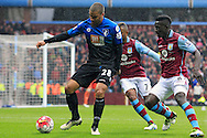 Lewis Grabban of Bournemouth (L) in action with Leandro Bacuna (C) and Idrissa Gana of Aston Villa.<br /> Barclays Premier League match, Aston Villa v AFC Bournemouth at Villa Park in Birmingham, The Midlands on Saturday 09th April 2016.<br /> Pic by Ian Smith, Andrew Orchard Sports Photography.