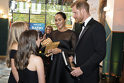 The Duke and Duchess of Sussex chat with children at the European Premiere of Disney's The Lion King at the Odeon Leicester Square, London.