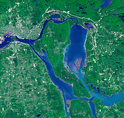 Sault Ste. Marie is the name of two cities on Saint Mary's River, separating Canada and the State of Michigan in the United States. Satellite image.