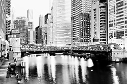 Chicago downtown at Clark Street Bridge along the Chicago River with Mather Tower (75 East Wacker Drive), Hotel 71 (71 East Wacker Drive), Aqua Building (430 East Waterside Drive), Carbide and Carbon Building (230 North Michigan Avenue),  Jewelers Building (35 East Wacker Drive), Kemper Building / Unitrin Building (1 East Wacker Drive), Leo Burnett building (35 West Wacker Drive), 55 West Wacker Drive building, and United Airlines building (77 West Wacker Drive)