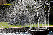 Wind blows water coming out of a fountain at a Chateau in Loriol-du-Comtat, France