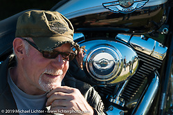 Former Harley dealer Erik Dunk of Adams Center, NY next to his 2003 Springer Softail at the AMCA swap meet in New Smyrina, FL during Daytona Bike Week, FL., USA. March 8, 2014.  Photography ©2014 Michael Lichter.