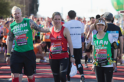 © Licensed to London News Pictures. 21/04/2013. London, England. L-R: Iwan Thomas, Sophie Raworth and Sian Williams. Celebrity Runners at a photocall before the start of the Virgin London Marathon 2013 race. Many wore black ribbons to pay their respect for those who died or were injured in the Boston Marathon. Photo credit: Bettina Strenske/LNP