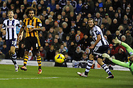 Hull city's Tom Huddlestone (8) shoots at goal but his shot is saved by West Brom keeper Ben Foster(r)    Barclays Premier league, West Bromwich Albion v Hull city at the Hawthorns in West Bromwich, England on Saturday 21st Dec 2013. pic by Andrew Orchard, Andrew Orchard sports photography.