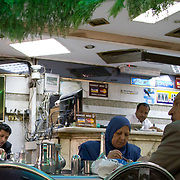 Diners tucking into a hearty meal of koshary, an Egyptian staple, at Koshary Abou Tarek in Downtown Cairo.