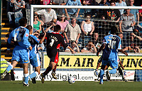 Photo: Alan Crowhurst.<br />Wycombe Wanderers v Lincoln City. Coca Cola League 2. 23/09/2006. Lincoln's Mark Stallard (C) breaks into the box to score 1-2.
