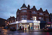 Business shop fronts at night in the Kings Heath area of Birmingham, United Kingdom. Kings Heath is a suburb of Birmingham, three miles south of the city centre. It is the next suburb south from Moseley.
