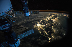 July 25, 2015 - Earth Atmosphere - Night Earth observation of Japan taken by Expedition 44 crewmember Scott Kelly, with a Soyuz Spacecraft connected to the Mini Research Module 1 (MRM1), and a Progress Spacecraft visible. Kelly posted this photo to Twitter on July 25 with the caption, Goodevening Japan. Showing Astro Kimiya how to take pictures of Earth at night. YearInSpace. (Credit Image: ? Scott Kelly/NASA via ZUMA Wire/ZUMAPRESS.com)