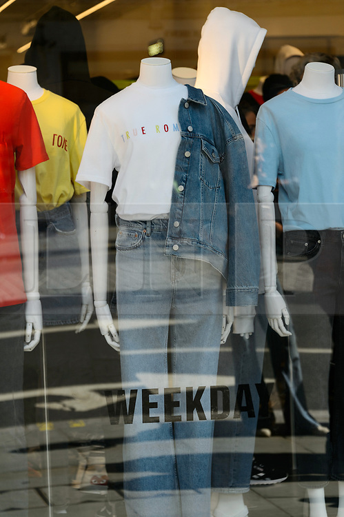 © Licensed to London News Pictures. 18/08/2017. London, UK. A window display at the opening of H&M group's first Weekday clothing store in Regent Street. Weekday is know for its offerings and minimalist styles, with 27 stores throughout Europe. The store is next to the H&M Arket lifestyle store. Photo credit: Ray Tang/LNP