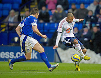 Bolton Wanderers' David N'Gog is carefully watched by Everton's Phil Jagielka ..Football - FA Challenge Cup Fourth Round - Bolton Wanderers v Everton - Saturday 26th January 2013 - Reebok stadium - Bolton..