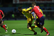 Chester striker Emmanuel Dieseruvwe (9) battles for the ball with York City defender Joe Davies during the Vanarama National League match between York City and Chester FC at Bootham Crescent, York, England on 13 November 2018.