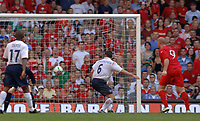 Photo: Henry Browne.<br /> Wales v England. FIFA World Cup Qualifying match.<br /> 03/09/2005.<br /> A header from John Hartson produces a fine save from England's Paul Robinson.