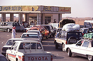 Cars line up to get gas at a gas station in Dhahran r Saudi Araba<br />Photograph ny Dennis Brack. bb78
