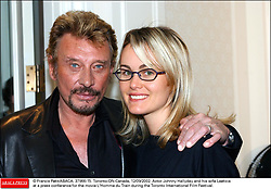 File photo : © Francis Petit/ABACA. 37966-15. Toronto-ON-Canada, 12/09/2002. Actor Johnny Hallyday and his wife Laeticiaat a press conference for the movie L'Homme du Train during the Toronto International Film Festival.