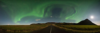 At 1AM the aurora spread out and filled almost the entire sky above southern Iceland, while the moon illuminated the landscape.